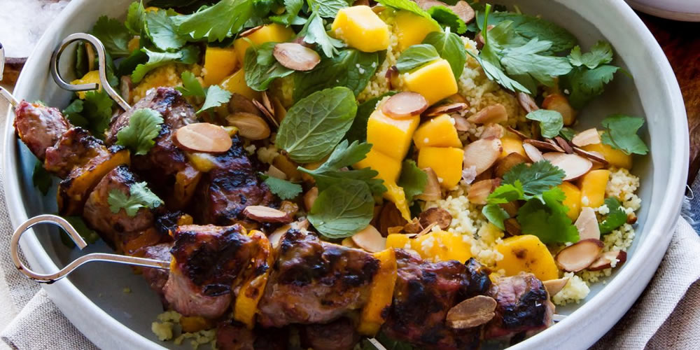 Grand final recipe inspo: Mango Glazed Lamb Skewers with Herby Mango Couscous Salad